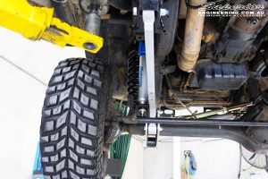 Mid left underbody shot looking forward of the fitted Superior Hyperflex Radius Arms, Nitro Gas Shocks and Coil Springs