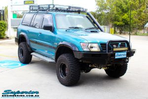 """Right front side view of a Blue Nissan GU Patrol after fitment of a Superior Nitro Gas Hyperflex 3"""" Inch Lift Kit with Superior Control Arms Long Arm Kit"""