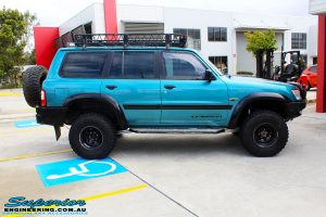 """Right side view of a Blue Nissan GU Patrol after fitment of a Superior Nitro Gas Hyperflex 3"""" Inch Lift Kit with Superior Control Arms Long Arm Kit"""