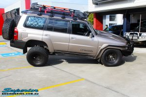 """Right side view of a Gold Nissan GU Patrol showing its flex before fitment of a Superior Remote Reservoir Hyperflex 4"""" Inch Lift Kit, Superior Control Arms Long Arm Kit, Superior Superflex Swaybar Front & Rear Kits, Superior 4340m Heim Joint Tie Rod with King Shocks"""