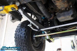 Front left underbody shot looking at the fitted Superior Hyperflex Radius Arm, Superflex Sway Bar Kit, Coil Spring & 4340m Heim Joint Tie Rod Solid Bar