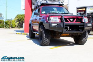 """Right front side view of a Red Nissan GU Patrol before fitment of a Superior Nitro Gas Hyperflex 5"""" Inch Lift Kit"""