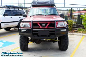 "Front on bonnet view of a Red Nissan GU Patrol after fitment of a Superior Nitro Gas Hyperflex 5"" Inch Lift Kit"