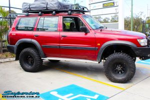 "Right side view of a Red Nissan GU Patrol after fitment of a Superior Nitro Gas Hyperflex 5"" Inch Lift Kit"