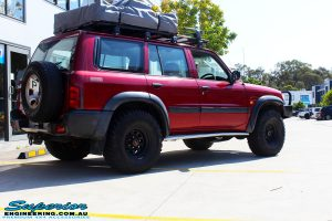 "Rear right side view of a Red Nissan GU Patrol before fitment of a Superior Nitro Gas Hyperflex 5"" Inch Lift Kit"