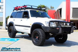"Right front side view of a White Nissan GU Patrol after fitment of a Superior Remote Reservoir Hyperflex 4"" Inch Lift Kit"