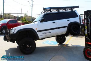 "Flexing result of a White Nissan GU Patrol after fitment of a Superior Remote Reservoir Hyperflex 4"" Inch Lift Kit"