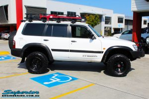 """Right side view of a White Nissan GU Patrol after fitment of a Superior Remote Reservoir Hyperflex 4"""" Inch Lift Kit"""