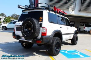 """Rear right side view of a White Nissan GU Patrol after fitment of a Superior Remote Reservoir Hyperflex 4"""" Inch Lift Kit"""