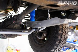 Front right underbody shot looking at the fitted Superior Nitro Gas Shock with Coil Spring, Superior Hyperflex Radius Arm and Superflex Sway Bar Kit