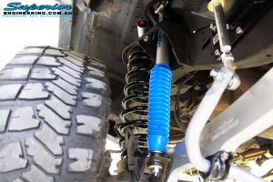 Inside left guard shot looking up at the fitted Superior Remote Reservoir Shock with Mount, Coil Spring & Sway Bar Extensions