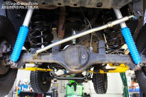 Rear mid underbody view looking at the fitted Superior Adjustable Panhard Rod, Remote Reservoir Shocks with Coil Springs & Sway Bar Kit