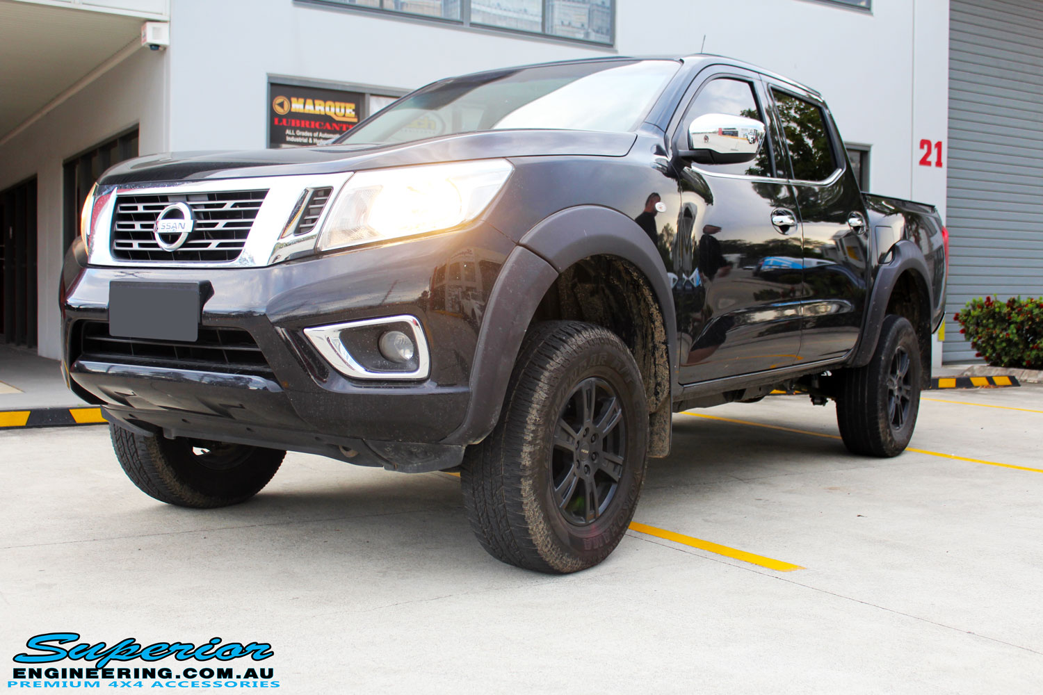 """Left front side view of a Nissan NP300 Navara Dual Cab after fitment of a Superior Nitro Gas 3"""" Inch Lift Kit"""