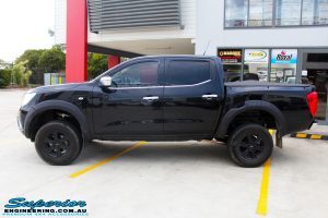 """Left side view of a Nissan NP300 Navara Dual Cab after fitment of a Superior Nitro Gas 3"""" Inch Lift Kit"""