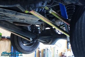Left rear mid shot of the fitted Superior Upper & Lower Control Arms, Nitro Gas Shocks with Coil Springs