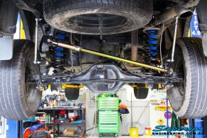 Rear mid underbody shot of the fitted Superior Adjustable Panhard Rod, Nitro Gas Stocks with Coil Springs and Swaybar Extensions