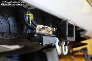 Rear underbody view of the switches and wiring for the Airbag Man Coil Air Helper Kit