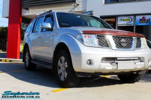 Right front side view of a Nissan R51 Pathfinder in Silver after fitment of a Airbag Man Standard Height Coil Air Kit
