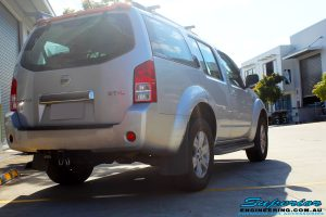 Rear right view of a Nissan R51 Pathfinder in Silver after fitment of a Airbag Man Standard Height Coil Air Kit