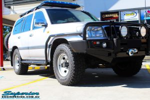 "Right front side view of a Silver Toyota 105 Landcruiser Wagon before fitment of a Superior Nitro Gas 2"" Inch Lift Kit, Snorkel & Eaton Harrop Front & Rear E-Lockers"