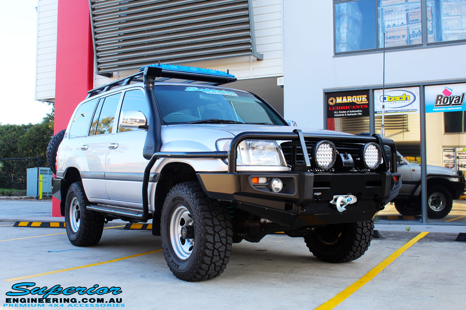 """Right front side view of a Silver Toyota 105 Landcruiser Wagon after fitment of a Superior Nitro Gas 2"""" Inch Lift Kit, Snorkel & Eaton Harrop Front & Rear E-Lockers"""