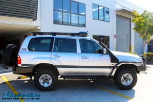 """Right side view of a Silver Toyota 105 Landcruiser Wagon after fitment of a Superior Nitro Gas 2"""" Inch Lift Kit, Snorkel & Eaton Harrop Front & Rear E-Lockers"""