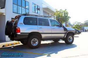 """Rear right view of a Silver Toyota 105 Landcruiser Wagon after fitment of a Superior Nitro Gas 2"""" Inch Lift Kit, Snorkel & Eaton Harrop Front & Rear E-Lockers"""
