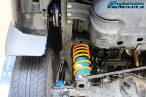Rear left shot of the fitted Remote Reservoir Shock + Coil Spring with Airbag Man Coil Air Kit Helper
