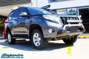 """Right front side view of a Grey Toyota 150 Landcruiser Prado Wagon after fitment of a Superior Remote Reservoir 2"""" Inch Lift Kit, Airbag Man Coil Air Kit & King Springs"""