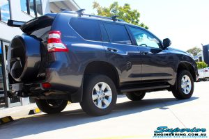 """Rear right view of a Grey Toyota 150 Landcruiser Prado Wagon after fitment of a Superior Remote Reservoir 2"""" Inch Lift Kit, Airbag Man Coil Air Kit & King Springs"""