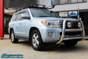 """Right front side view of a Blue Toyota 200 Series Landcruiser before fitment of a Superior Remote Reservoir 2"""" Inch Lift Kit & Airbag Man Coil Air Helper Kit"""