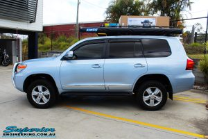 """Left side view of a Blue Toyota 200 Series Landcruiser after fitment of a Superior Remote Reservoir 2"""" Inch Lift Kit & Airbag Man Coil Air Helper Kit"""