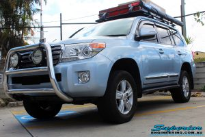 """Left front view of a Blue Toyota 200 Series Landcruiser after fitment of a Superior Remote Reservoir 2"""" Inch Lift Kit & Airbag Man Coil Air Helper Kit"""