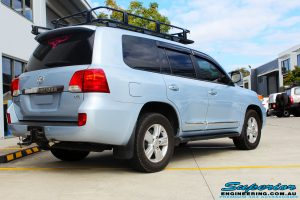 """Rear right side view of a Blue Toyota 200 Series Landcruiser before fitment of a Superior Remote Reservoir 2"""" Inch Lift Kit & Airbag Man Coil Air Helper Kit"""