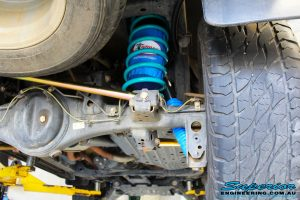 Rear right underbody shot showing the fitted Superior Remote Reservoir Shock Absorber, Coil Spring, Superior Rear Panhard Rod & Airbag Man Coil Air Helper Kit