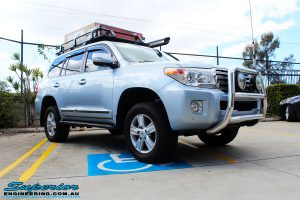 """Right front side view of a Blue Toyota 200 Series Landcruiser after fitment of a Superior Remote Reservoir 2"""" Inch Lift Kit & Airbag Man Coil Air Helper Kit"""