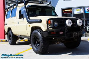 "Right front side view of a Beige Toyota 75 Series Landcruiser Troopcarrier before fitment of a EFS 2"" Inch Lift Kit"
