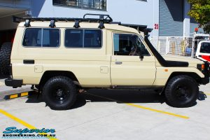 """Right side view of a Beige Toyota 75 Series Landcruiser Troopcarrier before fitment of a EFS 2"""" Inch Lift Kit"""