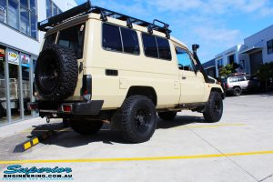 "Rear right view of a Beige Toyota 75 Series Landcruiser Troopcarrier before fitment of a EFS 2"" Inch Lift Kit"