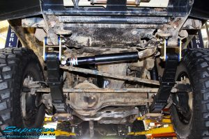 Front underbody shot of the fitted EFS Comfort Ride Springs, Steering Damper & Greaseable Shackles