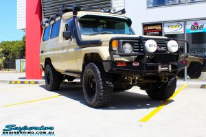 "Right front side view of a Beige Toyota 75 Series Landcruiser Troopcarrier after fitment of a EFS 2"" Inch Lift Kit"