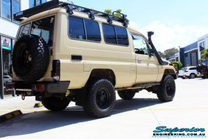 """Rear right view of a Beige Toyota 75 Series Landcruiser Troopcarrier after fitment of a EFS 2"""" Inch Lift Kit"""