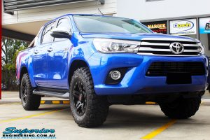 """Right front side view of a Toyota Revo Hilux Dual Cab in Blue before fitment of a 3"""" Inch Lift Kit with Superior Upper Control Arms and Diff Drop Kit"""