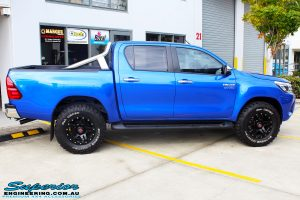 """Right side view of a Toyota Revo Hilux Dual Cab in Blue before fitment of a 3"""" Inch Lift Kit with Superior Upper Control Arms and Diff Drop Kit"""