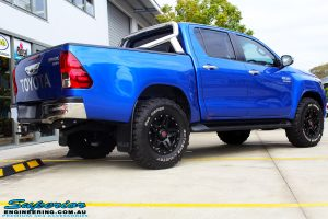 """Rear right view of a Toyota Revo Hilux Dual Cab in Blue before fitment of a 3"""" Inch Lift Kit with Superior Upper Control Arms and Diff Drop Kit"""
