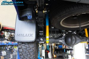 Rear left underbody view of the fitted Bilstein Shock Absorber, EFS Leaf Spring & Superior Diff Drop Kit