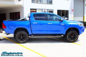 "Right side view of a Toyota Revo Hilux Dual Cab in Blue after fitment of a 3"" Inch Lift Kit with Superior Upper Control Arms and Diff Drop Kit"