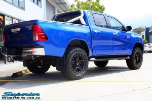"""Rear right view of a Toyota Revo Hilux Dual Cab in Blue after fitment of a 3"""" Inch Lift Kit with Superior Upper Control Arms and Diff Drop Kit"""