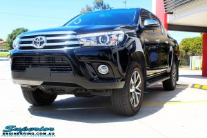 """Left front side view of a Toyota Revo Hilux Dual Cab in Black before fitment of a Superior Remote Reservoir 3"""" Inch Lift Kit"""