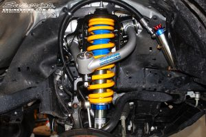 Front left inside guard view of the fitted Superior Front Strut with Coil Spring & Superior Chromoly Upper Control Arm